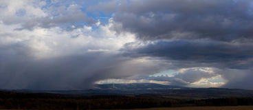 Panarama of storm running over a town Royalty Free Stock Photography