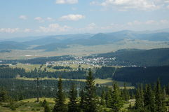 Panaroamic view to municipality Zabljak. The city is surrounded by in pine forest in nort part of Montenegro Royalty Free Stock Photo