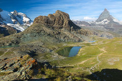 Panaroma in Swiss Alps with Rifelsee and Matterhorn, Switzerland royalty free stock photography