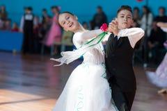 Panasyuk Maksim en Belyankina Liana Perform jeugd-1 Standaardprogramma Stock Foto