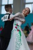 Panasyuk Maksim och Belyankina Liana Perform Juvenile-1 standart program Arkivbild