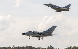 Panavia Tornado and a eurofighter typhoon lands on airport Royalty Free Stock Photo