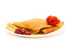 Pancake. With jam on white plate Stock Photos