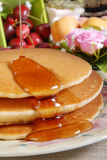 Pancake. And some sweet honey Royalty Free Stock Photos
