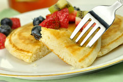 Pancake. With honey , maple syrup and berries close up Royalty Free Stock Photo