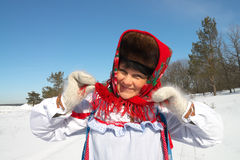 Pancake. Gay woman in folk costume on a sunny winter day Stock Photography