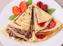 Pancake. Plate of pancake with chocolate and jam stock images