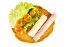 Pancake. A ham and cheese pancake with salad over white background Royalty Free Stock Images