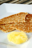 Pancake with applesauce on a white plate Stock Photography