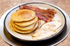 Pancake Bacon and Egg Breakfast on Gold Plate. Pancake Bacon and Egg Breakfast on Golden Plate Royalty Free Stock Images