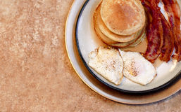 Pancake Bacon and Egg Breakfast on Large Gold Plate. Pancake Bacon and Egg Breakfast on Golden Plate Stock Image