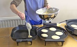 Pancake baking in a kitchen. For pancake tuesday before lent royalty free stock photos