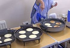 Pancake baking in a kitchen. For pancake tuesday before lent royalty free stock photo