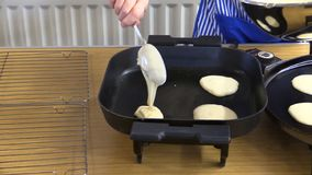 Pancake baking in a kitchen. For pancake tuesday before lent stock photos