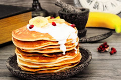 Pancake with Banana, Pomegranate and Sour Cream Stock Images