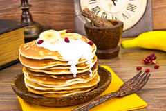 Pancake with Banana, Pomegranate and Sour Cream Royalty Free Stock Photography