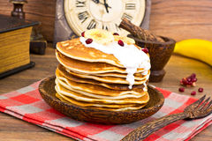 Pancake with Banana, Pomegranate and Sour Cream Royalty Free Stock Image