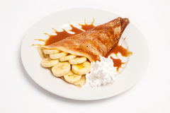 Pancake with banana and syrup. Studio shot Royalty Free Stock Photos
