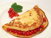 Pancake with berries. Pancake with red currant berries Stock Photo