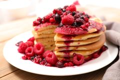 Pancake with berries. Close up on pancake with berries stock photography