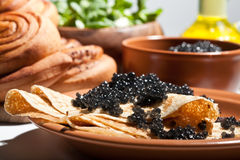 Pancake with black caviar royalty free stock images