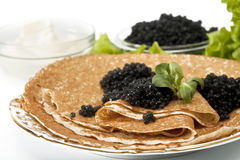 Pancake with black caviar Stock Photo