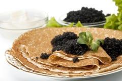 Pancake with black caviar stock photo