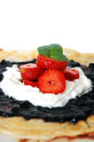Pancake with blueberries jam. Whipped cream, strawberries and chocolate Stock Images