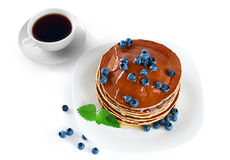 Pancake with blueberries, mint, coffee and honey on a white back Stock Photo