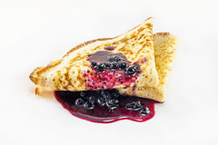 Pancake with blueberry jam. On white plate stock photography