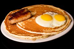 Pancake Breakfast. Pancakes, eggs and sausage for breakfast Royalty Free Stock Photos