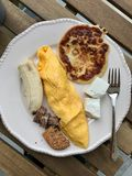 Pancake Breakfast with French Omelette, Banana, Meat, Cookie, Cheese and Coffee at on Wooden Table. Homemade Food stock image