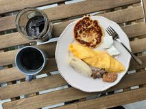 Pancake Breakfast with French Omelette, Banana, Meat, Cookie, Cheese and Coffee at on Wooden Table. Homemade Food royalty free stock photography