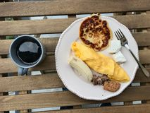 Pancake Breakfast with French Omelette, Banana, Meat, Cookie, Cheese and Coffee at on Wooden Table. Homemade Food royalty free stock image