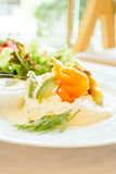 Pancake for breakfast. Pancake smoked salmon with avocado on top and vegetable in white plate - Healthy food style , Color Filter Processing Royalty Free Stock Image