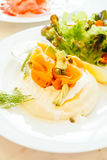 Pancake for breakfast. Pancake smoked salmon with avocado on top and vegetable in white plate - Healthy food style , Color Filter Processing Royalty Free Stock Photos