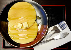 Pancake with butter and honey Royalty Free Stock Photos
