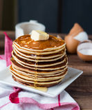 Pancake with butter, honey and milk, sweet breakfast Stock Photo
