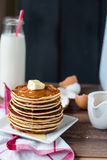 Pancake with butter, honey and milk, sweet breakfast Royalty Free Stock Photography