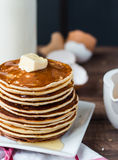 Pancake with butter, honey and milk, sweet breakfast Royalty Free Stock Images