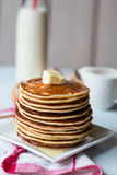 Pancake with butter, honey and milk, sweet breakfast Stock Photos