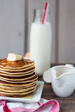 Pancake with butter, honey and milk, sweet breakfast Stock Images