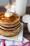 Pancake with butter, honey and milk, sweet breakfast Royalty Free Stock Image