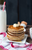 Pancake with butter, honey and milk, sweet breakfast Stock Image