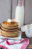 Pancake with butter, honey and milk, sweet breakfast Royalty Free Stock Photo