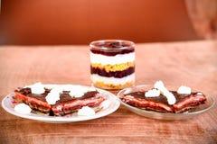 Pancake cake with fresh raspberry, pistachios dark chocolate Royalty Free Stock Photos