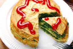 Pancake cake with spinach Stock Photos