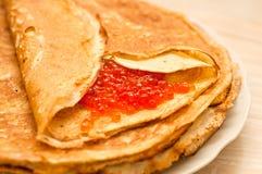 Pancake with caviar Stock Image