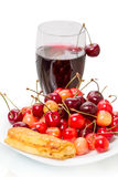 Pancake with cherries and cherry juice. Pancake, sweet cherries on a white plate and glass of cherry juice Stock Photos