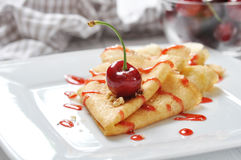 Pancake with cherry Stock Image